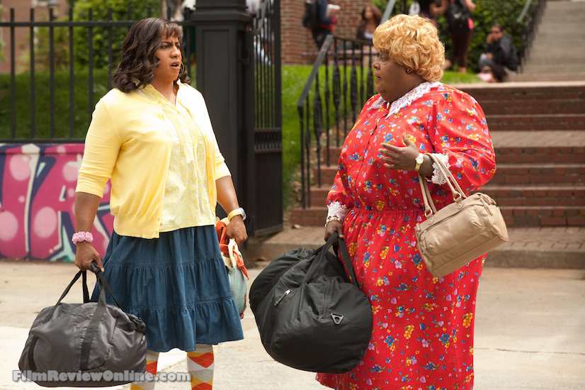 Martin Lawrence as Big Momma carrying another host home for you in her bag in the epically epic Big Momma's House